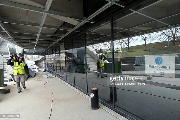 A labourer works at the new Philharmonie de Paris ahead of its opening in Paris on January 13 2015 The Philharmonie de Paris opens on January 14 in...