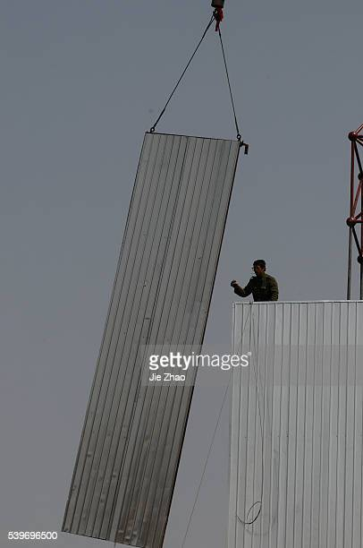 Labourers work at a precast concrete plant in Changzhi Shanxi province April 8 2010 VCP