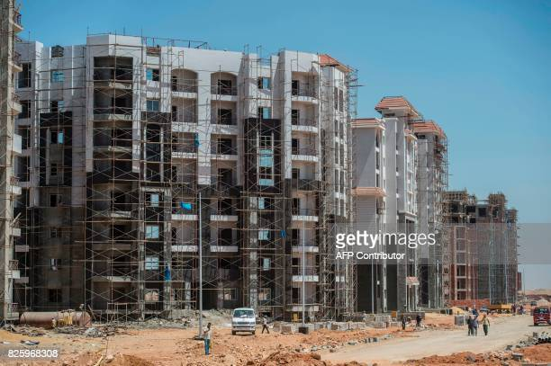 Labourers work at the construction site of the new Egyptian administrative capital some 40 kms east of Cairo on August 3 2017 Egypt plans to build a...