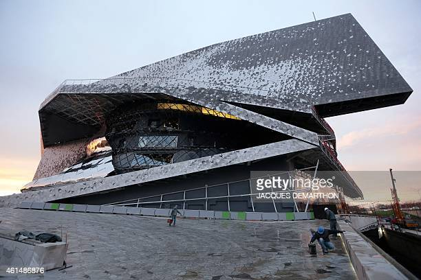 Labourers work at the new Philharmonie de Paris ahead of its opening in Paris on January 13 2015 The Philharmonie de Paris opens on January 14 in the...