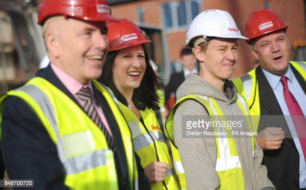 Labour's front bench shadow housing minister Jack Dromey chief secretary to the treasury Rachel Reeves and shadow chancellor Ed Balls visit a social...