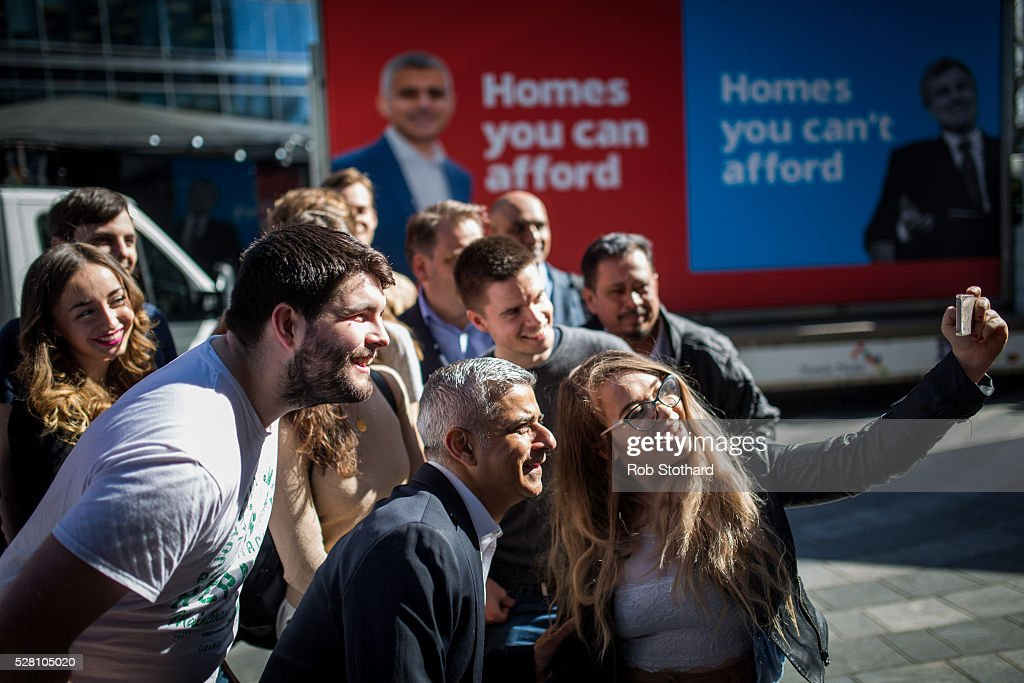Labour's London Mayoral candidate <a gi-track='captionPersonalityLinkClicked' href=/galleries/search?phrase=Sadiq+Khan&family=editorial&specificpeople=3431876 ng-click='$event.stopPropagation()'>Sadiq Khan</a> and member of Parliament for Tooting poses for a selfie with supporters in Montgomery Square in Canary Wharf on May 4, 2016 in London, England. Londoners will go to the polls tomorrow to vote for Mayor Of London with Labour's candidate expected to beat Conservative Party rival Zac Goldsmith to the position.