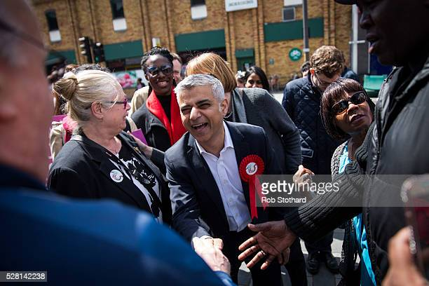 Labour's London Mayoral candidate Sadiq Khan and member of Parliament for Tooting speaks to supporters at East Street Market in Walworth on May 4...