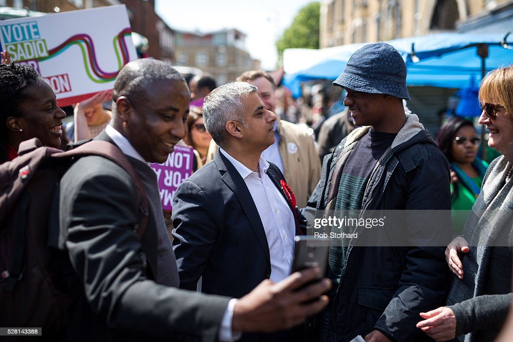 Labour's London Mayoral candidate <a gi-track='captionPersonalityLinkClicked' href=/galleries/search?phrase=Sadiq+Khan&family=editorial&specificpeople=3431876 ng-click='$event.stopPropagation()'>Sadiq Khan</a> and member of Parliament for Tooting speaks to a member of the public whilst walking through East Street Market in Walworth on May 4, 2016 in London, England. Londoners will go to the polls tomorrow to vote for Mayor Of London with Labour's candidate expected to beat Conservative Party rival Zac Goldsmith to the position.