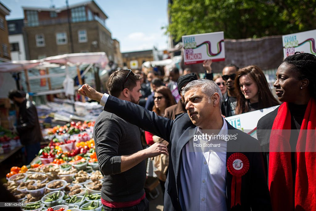 Labour's London Mayoral candidate Sadiq Khan and member of Parliament for Tooting speaks to traders at East Street Market in Walworth on May 4, 2016 in London, England. Londoners will go to the polls tomorrow to vote for Mayor Of London with Labour's candidate expected to beat Conservative Party rival Zac Goldsmith to the position.