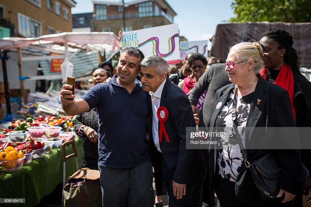 Labour's London Mayoral candidate <a gi-track='captionPersonalityLinkClicked' href=/galleries/search?phrase=Sadiq+Khan&family=editorial&specificpeople=3431876 ng-click='$event.stopPropagation()'>Sadiq Khan</a> and member of Parliament for Tooting poses for a photograph with a trader at East Street Market in Walworth on May 4, 2016 in London, England. Londoners will go to the polls tomorrow to vote for Mayor Of London with Labour's candidate expected to beat Conservative Party rival Zac Goldsmith to the position.