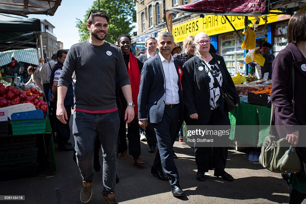 Labour's London Mayoral candidate Sadiq Khan and member of Parliament for Tooting walk through East Street Market in Walworth on May 4, 2016 in London, England. Londoners will go to the polls tomorrow to vote for Mayor Of London with Labour's candidate expected to beat Conservative Party rival Zac Goldsmith to the position.