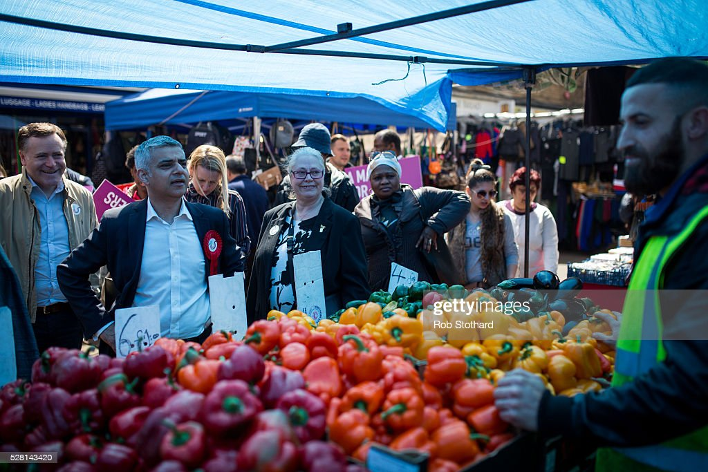 Labour's London Mayoral candidate Sadiq Khan and member of Parliament for Tooting speaks to a trader at East Street Market in Walworth on May 4, 2016 in London, England. Londoners will go to the polls tomorrow to vote for Mayor Of London with Labour's candidate expected to beat Conservative Party rival Zac Goldsmith to the position.