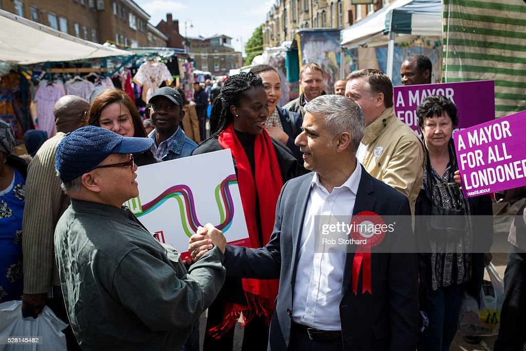 Labour's London Mayoral candidate <a gi-track='captionPersonalityLinkClicked' href=/galleries/search?phrase=Sadiq+Khan&family=editorial&specificpeople=3431876 ng-click='$event.stopPropagation()'>Sadiq Khan</a> and member of Parliament for Tooting shakes hands with a shopper at East Street Market in Walworth on May 4, 2016 in London, England. Londoners will go to the polls tomorrow to vote for Mayor Of London with Labour's candidate expected to beat Conservative Party rival Zac Goldsmith to the position.