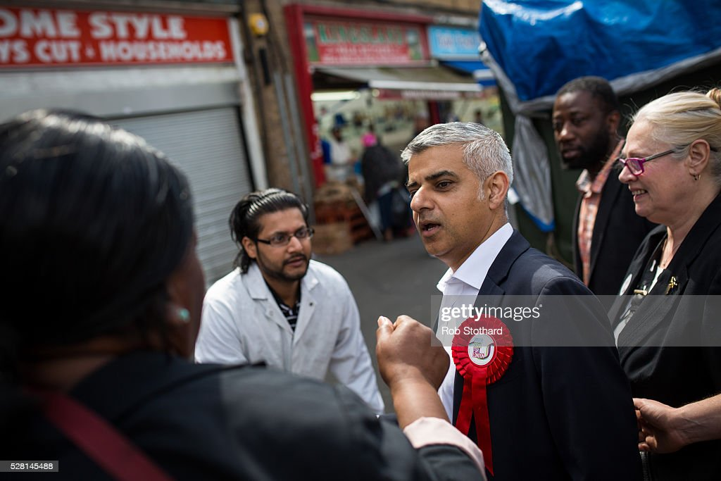 Labour's London Mayoral candidate <a gi-track='captionPersonalityLinkClicked' href=/galleries/search?phrase=Sadiq+Khan&family=editorial&specificpeople=3431876 ng-click='$event.stopPropagation()'>Sadiq Khan</a> and member of Parliament for Tooting speaks to a shopper at East Street Market in Walworth on May 4, 2016 in London, England. Londoners will go to the polls tomorrow to vote for Mayor Of London with Labour's candidate expected to beat Conservative Party rival Zac Goldsmith to the position.