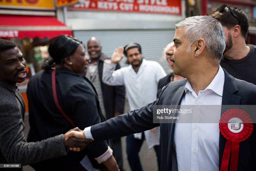 Labour's London Mayoral candidate Sadiq Khan and member of Parliament for Tooting shakes hands with a shopper at East Street Market in Walworth on May 4, 2016 in London, England. Londoners will go to the polls tomorrow to vote for Mayor Of London with Labour's candidate expected to beat Conservative Party rival Zac Goldsmith to the position.