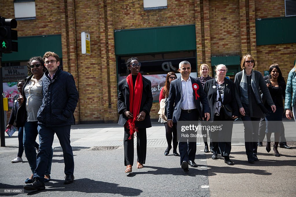 Labour's London Mayoral candidate Sadiq Khan and member of Parliament for Tooting crosses Walworth Road with Harriet Harman, member of Parliament for Camberwell and Peckham, and his campaign team on May 4, 2016 in London, England. Londoners will go to the polls tomorrow to vote for Mayor Of London with Labour's candidate expected to beat Conservative Party rival Zac Goldsmith to the position.