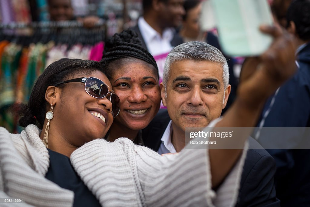 Labour's London Mayoral candidate <a gi-track='captionPersonalityLinkClicked' href=/galleries/search?phrase=Sadiq+Khan&family=editorial&specificpeople=3431876 ng-click='$event.stopPropagation()'>Sadiq Khan</a> and member of Parliament for Tooting poses for a photograph with traders at East Street Market in Walworth on May 4, 2016 in London, England. Londoners will go to the polls tomorrow to vote for Mayor Of London with Labour's candidate expected to beat Conservative Party rival Zac Goldsmith to the position.