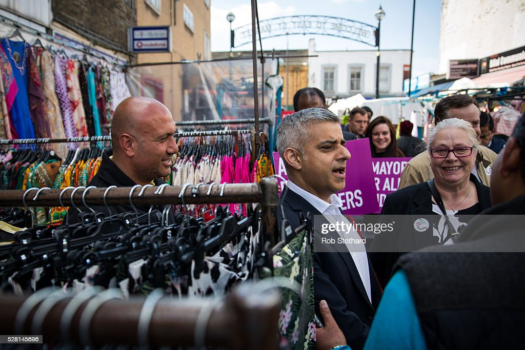 Labour's London Mayoral candidate Sadiq Khan and member of Parliament for Tooting walks through East Street Market in Walworth on May 4, 2016 in London, England. Londoners will go to the polls tomorrow to vote for Mayor Of London with Labour's candidate expected to beat Conservative Party rival Zac Goldsmith to the position.