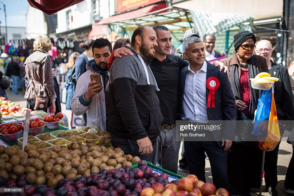 Labour's London Mayoral candidate Sadiq Khan and member of Parliament for Tooting poses for a photograph with traders at East Street Market in Walworth on May 4, 2016 in London, England. Londoners will go to the polls tomorrow to vote for Mayor Of London with Labour's candidate expected to beat Conservative Party rival Zac Goldsmith to the position.