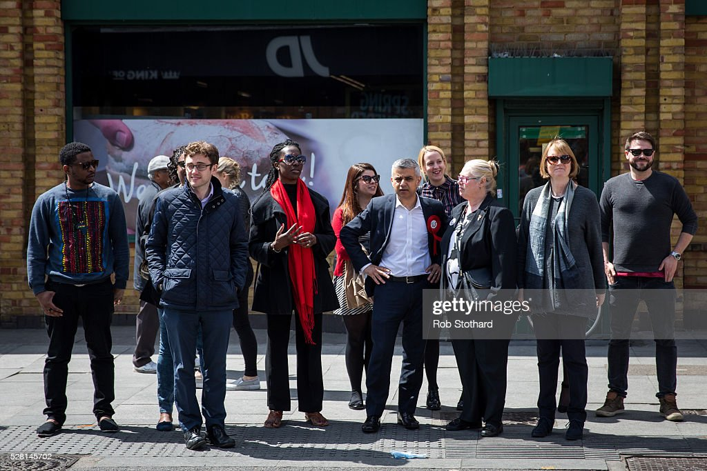 Labour's London Mayoral candidate <a gi-track='captionPersonalityLinkClicked' href=/galleries/search?phrase=Sadiq+Khan&family=editorial&specificpeople=3431876 ng-click='$event.stopPropagation()'>Sadiq Khan</a> and member of Parliament for Tooting waits to cross Walworth Road with Harriet Harman, member of Parliament for Camberwell and Peckham, his campaign team on May 4, 2016 in London, England. Londoners will go to the polls tomorrow to vote for Mayor Of London with Labour's candidate expected to beat Conservative Party rival Zac Goldsmith to the position.