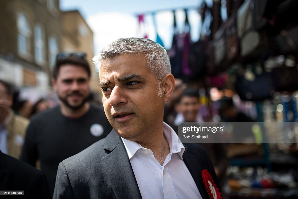 Labour's London Mayoral candidate <a gi-track='captionPersonalityLinkClicked' href=/galleries/search?phrase=Sadiq+Khan&family=editorial&specificpeople=3431876 ng-click='$event.stopPropagation()'>Sadiq Khan</a> and member of Parliament for Tooting walks through East Street Market in Walworth on May 4, 2016 in London, England. Londoners will go to the polls tomorrow to vote for Mayor Of London with Labour's candidate expected to beat Conservative Party rival Zac Goldsmith to the position.