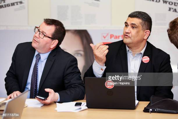 Labour's Rongotai candidate Paul Eagle and MP Grant Robertson talk in between making campaign calls at Eagle's phone bank on September 21 2017 in...