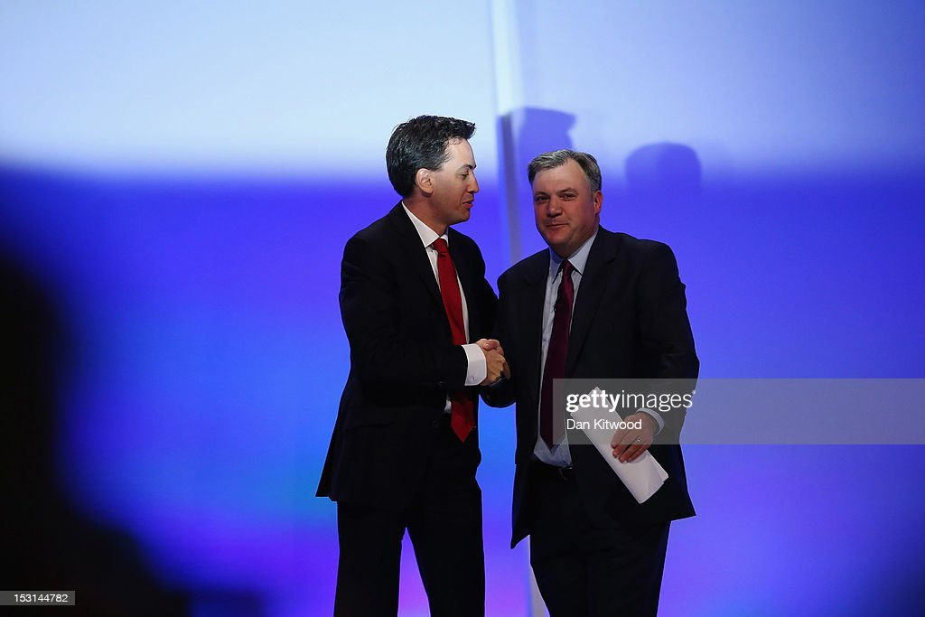 Labour's Shadow Chancellor <a gi-track='captionPersonalityLinkClicked' href=/galleries/search?phrase=Ed+Balls&family=editorial&specificpeople=3244683 ng-click='$event.stopPropagation()'>Ed Balls</a> (R) is congratulated by Labour leader <a gi-track='captionPersonalityLinkClicked' href=/galleries/search?phrase=Ed+Miliband&family=editorial&specificpeople=4376337 ng-click='$event.stopPropagation()'>Ed Miliband</a> after delivering his keynote speech to delegates at the Labour Party Conference at Manchester Central on October 1, 2012 in Manchester, England. Labour shadow chancellor <a gi-track='captionPersonalityLinkClicked' href=/galleries/search?phrase=Ed+Balls&family=editorial&specificpeople=3244683 ng-click='$event.stopPropagation()'>Ed Balls</a> unveiled his plans to stimulate the economy, using a GBP 3bn windfall from the sale of 4G mobile phone frequencies to build 100,000 affordable homes and give stamp duty breaks to first time buyers.