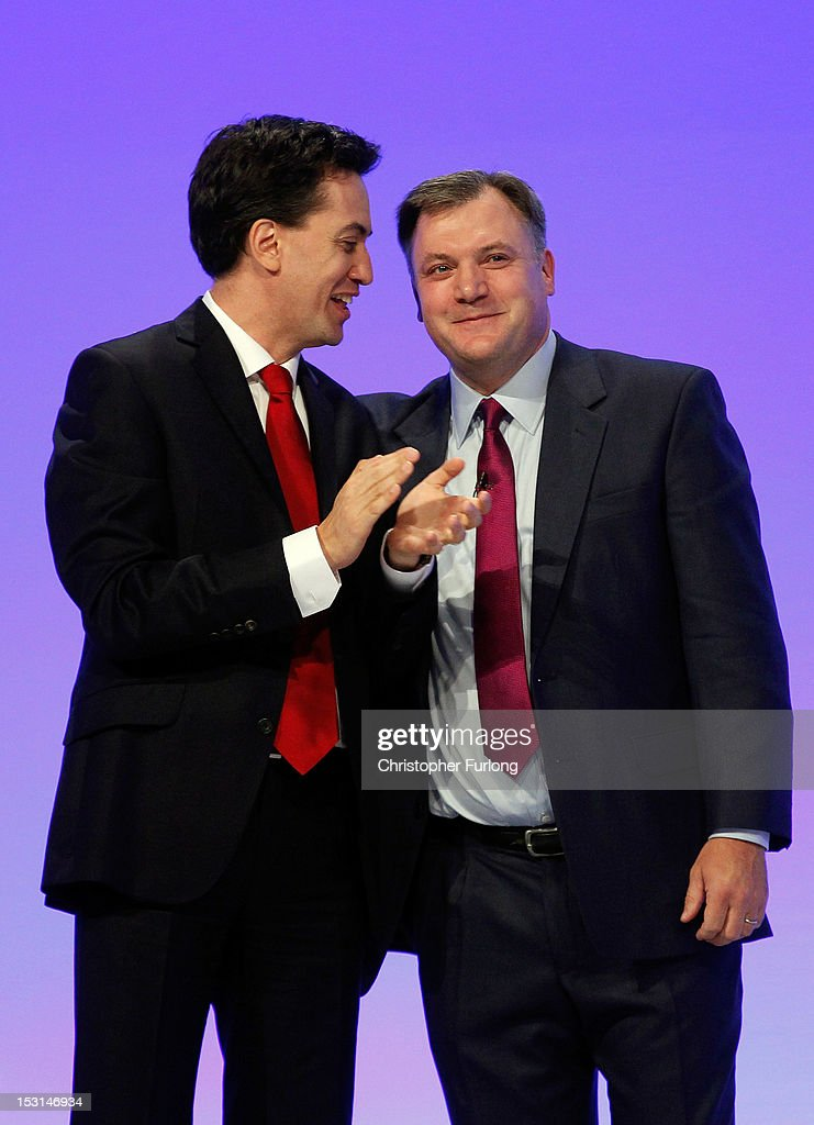 Labour's Shadow Chancellor <a gi-track='captionPersonalityLinkClicked' href=/galleries/search?phrase=Ed+Balls&family=editorial&specificpeople=3244683 ng-click='$event.stopPropagation()'>Ed Balls</a> (R) is congratulated by Labour leader Ed Miliband after delivering his keynote speech to delegates at the Labour Party Conference at Manchester Central on October 1, 2012 in Manchester, England. Labour shadow chancellor <a gi-track='captionPersonalityLinkClicked' href=/galleries/search?phrase=Ed+Balls&family=editorial&specificpeople=3244683 ng-click='$event.stopPropagation()'>Ed Balls</a> unveiled his plans to stimulate the economy, using a GBP 3bn windfall from the sale of 4G mobile phone frequencies to build 100,000 affordable homes and give stamp duty breaks to first time buyers.