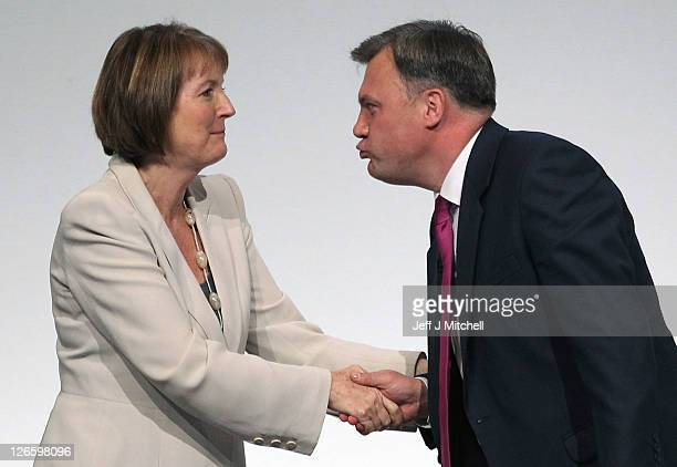 Labour's Shadow Chancellor Ed Balls leans over to kiss deputy party leader Harriet Harman as he receives applause after addressing the Labour party...