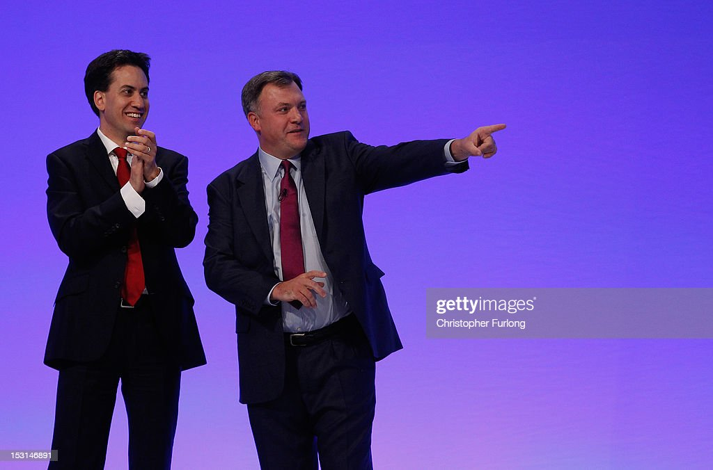 Labour's Shadow Chancellor <a gi-track='captionPersonalityLinkClicked' href=/galleries/search?phrase=Ed+Balls&family=editorial&specificpeople=3244683 ng-click='$event.stopPropagation()'>Ed Balls</a> (R) points as he is appplauded by Labour leader Ed Miliband after delivering his keynote speech to delegates at the Labour Party Conference at Manchester Central on October 1, 2012 in Manchester, England. Labour shadow chancellor <a gi-track='captionPersonalityLinkClicked' href=/galleries/search?phrase=Ed+Balls&family=editorial&specificpeople=3244683 ng-click='$event.stopPropagation()'>Ed Balls</a> unveiled his plans to stimulate the economy, using a GBP 3bn windfall from the sale of 4G mobile phone frequencies to build 100,000 affordable homes and give stamp duty breaks to first time buyers.