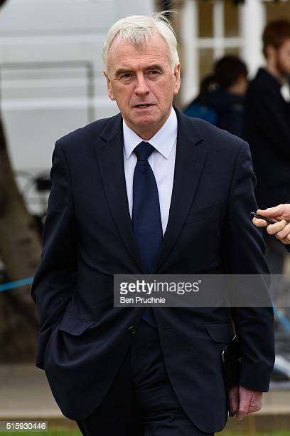 Labour's Shadow Chancellor John McDonnell is interviewed as he walks through Westminster British Chancellorof the Exchequer George Osborne reveals...