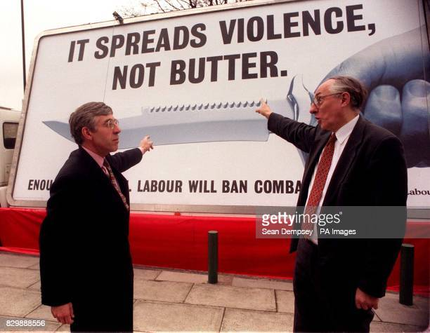 Labour's shadow Home Secretary Jack Straw and the Party's Chief Whip Donald Dewar point towards the party's latest 'advan' poster in support of...