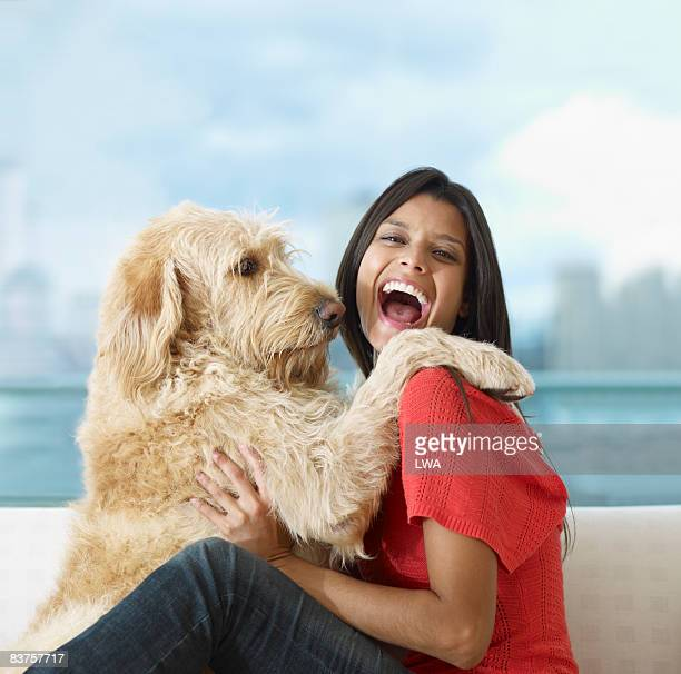 Labradoodle Giving Woman a Hug