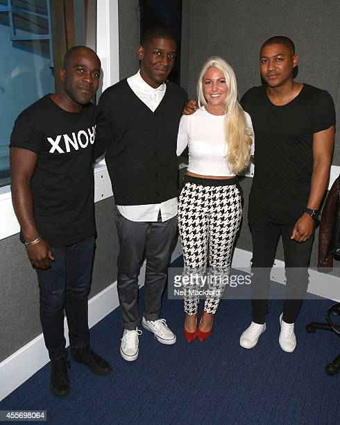 Labrinth with Melvin O'Doom Charlie Hedges and Ricky Haywood at the Kiss FM UK Studio's on September 19 2014 in London England