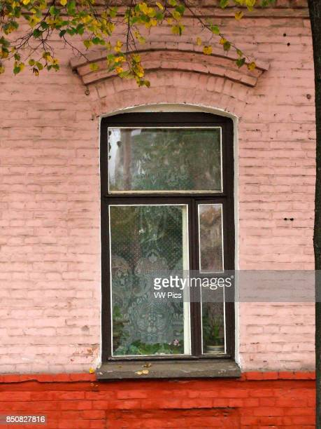 Lace curtains in a window in an old brick building in the old city of Vitebsk Belarus