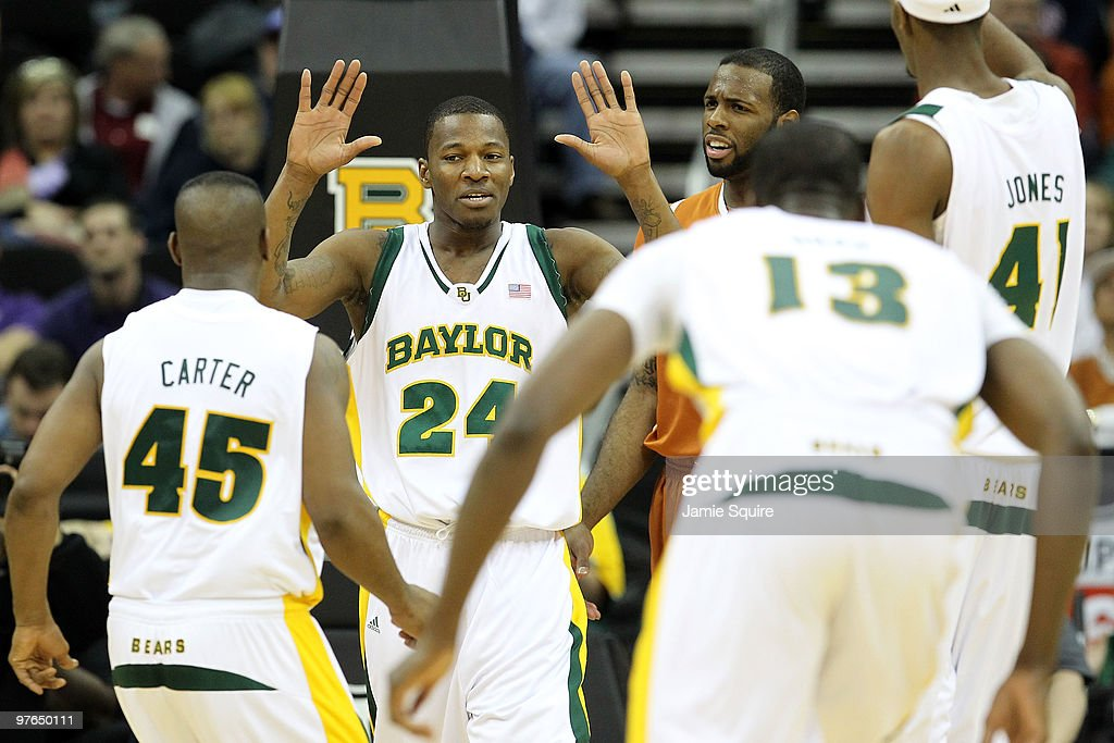 LaceDarius Dunn #24 of the Baylor Bears reacts with teammates in the second half while taking on the Texas Longhorns during the quarterfinals of the 2010 Phillips 66 Big 12 Men's Basketball Tournament at the Sprint Center on March 11, 2010 in Kansas City, Missouri.