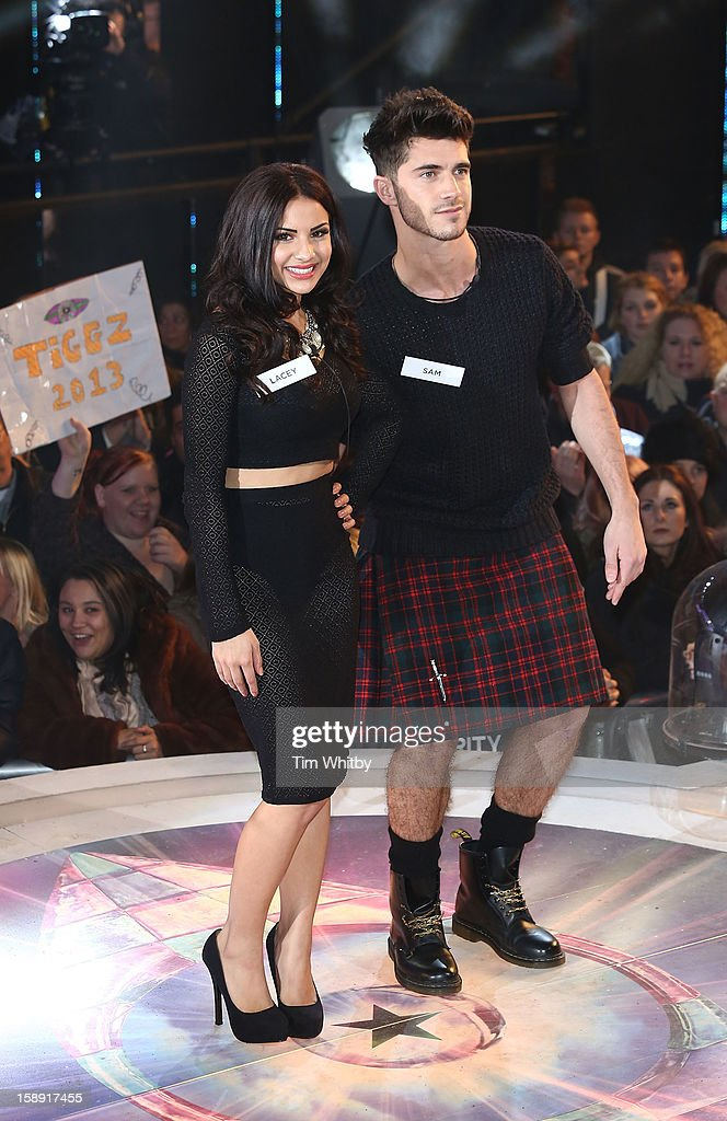 Lacey Banghard and Samuel Robertson enter the Celebrity Big Brother House at Elstree Studios on January 3, 2013 in Borehamwood, England.