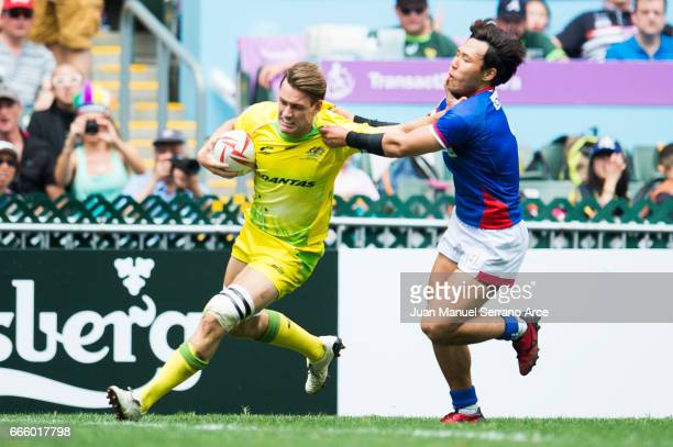 Lachie Aderson of Australia is tackled during the 2017 Hong Kong Sevens match between Australia and South Korea at Hong Kong Stadium on April 8 2017...
