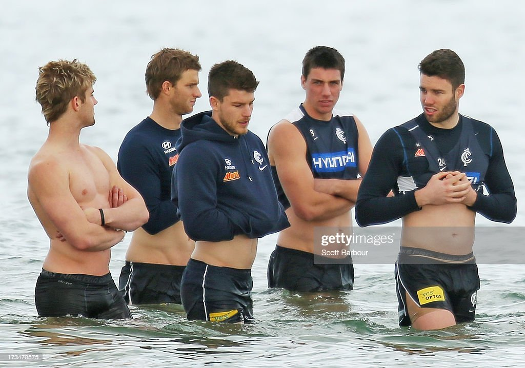 Lachie Henderson, Bryce Gibbs, Matthew Kreuzer and Patrick McCarthy of the Blues look on during a Carlton Blues AFL Recovery Session at St Kilda Sea Baths on July 15, 2013 in Melbourne, Australia.