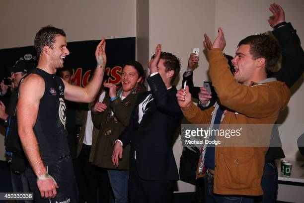 Lachie Henderson of the Blues celebrates their win with fans during the round 18 AFL match between the Carlton Blues and the North Melbourne...