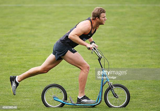Lachie Henderson of the Blues rides a scooter during a Carlton Blues AFL preseason training session at Visy Park on November 17 2014 in Melbourne...