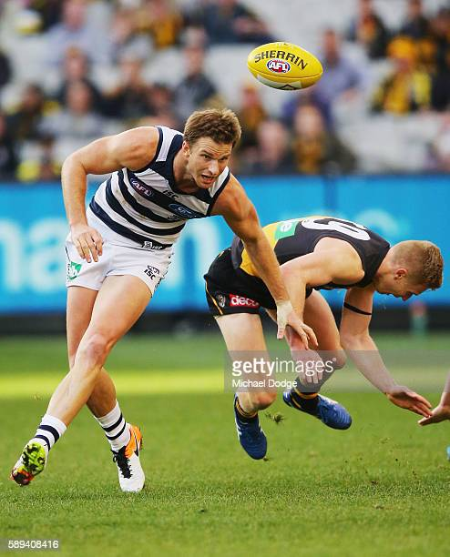 Lachie Henderson of the Cats and Taylor Hunt of the Tigers collide during the round 21 AFL match between the Richmond Tigers and the Geelong Cats at...