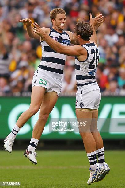 Lachie Henderson of the Cats celebrates a goal with Tom Hawkins during the round one AFL match between the Geelong Cats and the Hawthorn Hawks at...