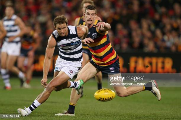 Lachie Henderson of the Cats is tackled by Josh Jenkins of the Crows during the 2017 AFL round 18 match between the Adelaide Crows and the Geelong...