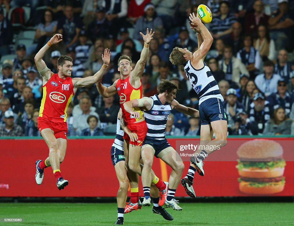 Lachie Henderson of the Cats marks the ball against Tom Lynch of the Suns during the round six AFL match between the Geelong Cats and the Gold Coast Suns at Simonds Stadium on April 30, 2016 in Geelong, Australia.