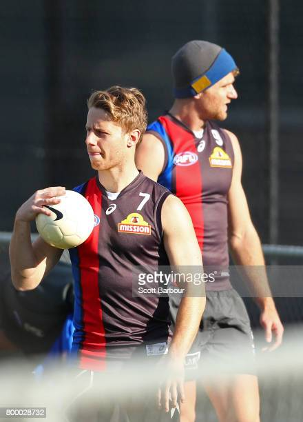 Lachie Hunter of the Bulldogs and Jake Stringer of the Bulldogs look on during a Western Bulldogs AFL training session at Whitten Oval on June 23...