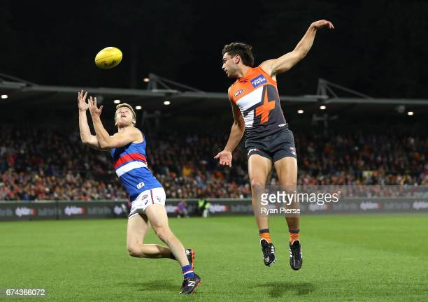 Lachie Hunter of the Bulldogs marks over Tim Taranto of the Giants during the round six AFL match between the Greater Western Sydney Giants and the...