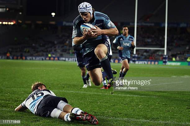 Lachie Munro of the Blues jumps over Lachie Turner of the Waratahs to score a try during the Super Rugby qualifier match between the Blues and the...