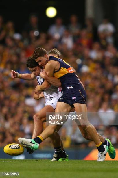 Lachie Neale of the Dockers and Jack Redden of the Eagles contest for the ball during the round six AFL match between the West Coast Eagles and the...
