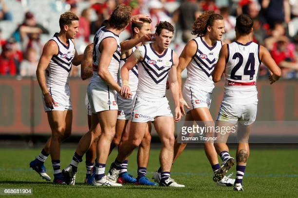 Lachie Neale of the Dockers celebrates a goal during the round four AFL match between the Melbourne Demons and the Fremantle Dockers at Melbourne...