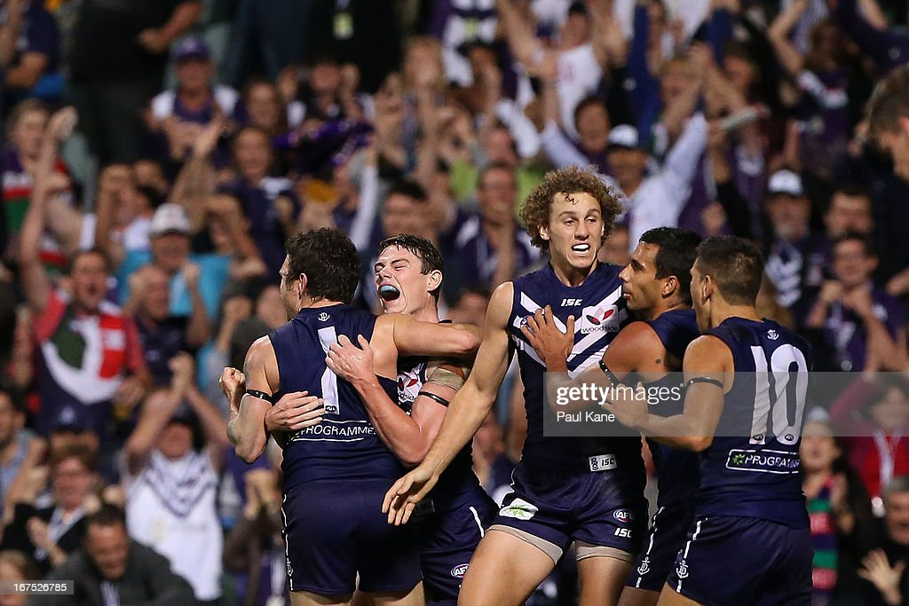 Lachie Neale of the Dockers congratulates Hayden Ballantyne after kicking a goal during the round five AFL match between the Fremantle Dockers and the Richmond Tigers at Patersons Stadium on April 26, 2013 in Perth, Australia.