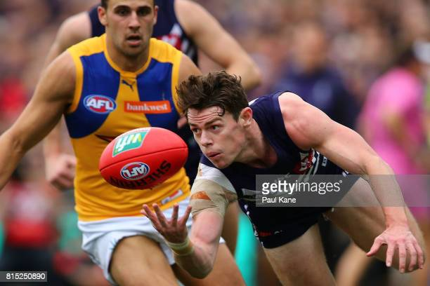 Lachie Neale of the Dockers gathers the ball during the round 17 AFL match between the Fremantle Dockers and the West Coast Eagles at Domain Stadium...