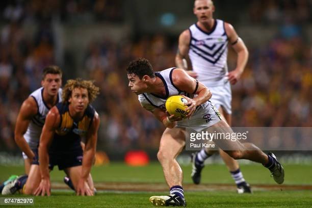 Lachie Neale of the Dockers gathers the ball during the round six AFL match between the West Coast Eagles and the Fremantle Dockers at Domain Stadium...