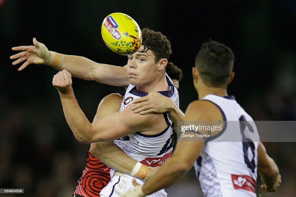 Lachie Neale of the Dockers gets a handball out during the round 10 AFL match between the St Kilda Saints and the Fremantle Dockers at Etihad Stadium on May 28, 2016 in Melbourne, Australia.